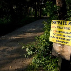The private portion of Cedar Beach Road has been closed by neighbors Charles and Sally Abrahamson since 2011.