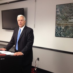 Democratic gubernatorial candidate and U.S. Rep. Mike Michaud speaks with reporters Friday at the Portland International Jetport.