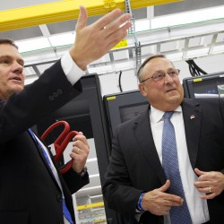 Oxford Networks President Craig Gunderson (left) shows Gov. Paul LePage around the company's expanded facility on Wednesday in Brunswick.
