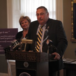 Gov. Paul LePage, joined by his wife, Ann, discusses the need to combat domestic violence at a news conference Tuesday at the Blaine House in Augusta.