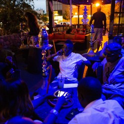A group of friends hang out at Kush Mediterranean Grill & Hookah Lounge in Dallas in this June 2014 file photo.