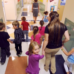 Teachers escort children through the halls of Ellsworth Elementary-Middle School. It is much more difficult to be a teacher in Maine than in most other states, according to an analysis by WalletHub.