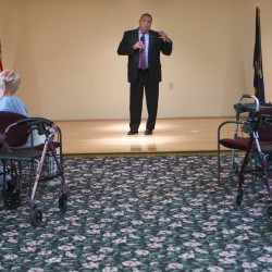Gov. Paul LePage gestures while talking on Wednesday at Ellen Leach Home in Brewer.