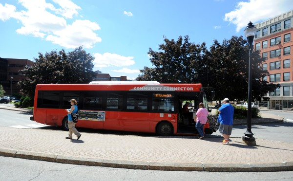 People get on a Community Connector bus in downtown Bangor in this August 2013 file photo.