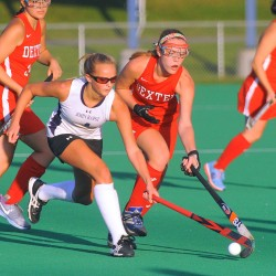 John Bapst's Courtney Prue (left) and Dexter High School's Katilyn Hall battle for the ball during the first half of a field hockey game in Orono last year.