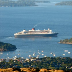 The Queen Mary 2, which at 1,132 feet long is the longest cruise ship to visit Maine this summer, leaves Frenchman Bay after making a daylong stop at Bar Harbor on Sept. 18, 2014.