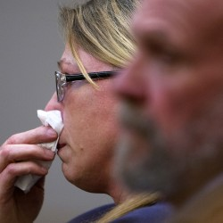 Donna Dray, 46 of Brewer, wipes a tear from her face as she listens to members of her family speak on her behalf during her sentencing Tuesday at Courtroom 302 in the Penobscot Judicial Center in Bangor. Dray was accused of robbing an elderly woman in May of her medication after holding a pillow over her face. Dray pleaded guilty and was sentenced to five years of jail.