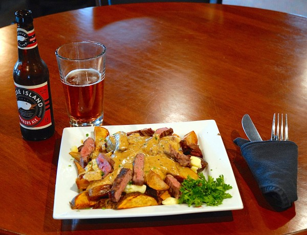 This is not your memere's poutine: At the Inn of Acadia in Madawaska, executive chef Samantha Berry has upped the ante on the ubiquitous Quebecois dish of french fries, cheese curds and gravy by morphing it into a gourmet offering of potato wedges, curds, a brandy-pepper sauce and sliced sirloin in a &quotPoutine au Poivre.&quot