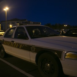 Several law enforcement vehicles were parked at The Grove apartment complex in Orono in 2013.