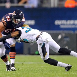 Matt Mulligan of the Chicago Bears (left), seen being tackled by Jacksonville's Demetrius McCray during an Aug. 14 preseason game, has been cut by the NFL team. The Enfield native formerly played at the University of Maine.