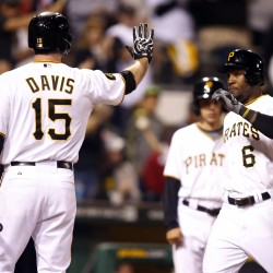 Pittsburgh Pirates first baseman Ike Davis (15) greets left fielder Starling Marte (6) at home plate after Marte hit a solo home run against the Boston Red Sox during the fifth inning Thursday night in Pittsburgh.