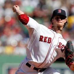 Pitcher Clay Buchholz (11) delivers against the New York Yankees at Fenway Park on Sunday.