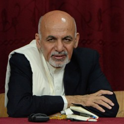 Afghan President Ashraf Ghani listens to teachers during his visit to the Amani High School in Kabul on Tuesday.