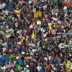 "Some of hundreds of thousands take part in the ""People's Climate March"" through Midtown, New York, Sept. 21, 2014."