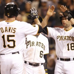 Pittsburgh Pirates first baseman Ike Davis (15) is greeted at home plate by left fielder Starling Marte (6) and second baseman Neil Walker (18) after Davis hit a three-run home run against the Boston Red Sox during the fifth inning Wednesday night in Pittsburgh.