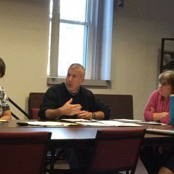 Orono police Chief Josh Ewing speaks to a town council subcommittee about plans to amend two ordinances dealing with disorderly properties and recovering costs for large events.
