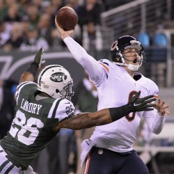 Chicago Bears quarterback Jay Cutler (6) throws under pressure from New York Jets strong safety Dawan Landry (26) during the first half at MetLife Stadium in East Rutherford, N.J., Monday night.