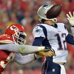 Kansas City Chiefs outside linebacker Tamba Hali (91) hits New England Patriots quarterback Tom Brady (12) while passing during the second half at Arrowhead Stadium in Kansas City Monday night.