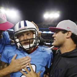 Tennessee Titans kicker Rob Bironas (center) celebrates with Rusty Smith (left) after Bironas kicked a 40-yard field goal to lead the Titans to a win in Nashville, Tennessee, in this October 2012 file photo.