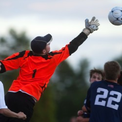 Presque Isle goalkeeper Andrew Paterson (left) leaps for the ball from a corner kick from Ellsworth during their soccer game at Ellsworth on Tuesday.