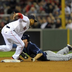 Tampa Bay's Matt Joyce is tagged out trying to steal second base by Boston second baseman Mookie Betts during the fifth inning at Fenway Park in Boston Tuesday night.