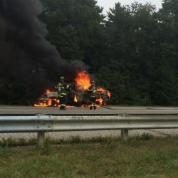 Two women jumped out of this truck before it burst into flames Sunday on the northbound side of Interstate 95 in Scarborough.