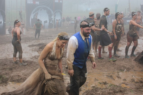 Steve and Jennifer Fisher cross the Wintergreen Mountain Spartan Race finish line on Aug. 23.