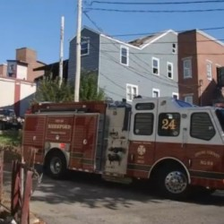 A fire truck sits near the scene of a Thursday morning fire that injured eight in Biddeford.
