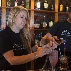 Humble Comfort owner Meghan Black (left) and Justin Eames make drinks at Black's newly opened restaurant on South Main Street in Brewer Friday.