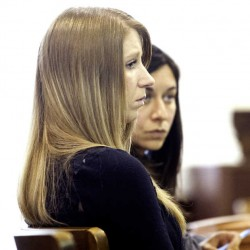 Kristina Lowe sits through the opening statement at her jury trail Thursday, May 15, at Oxford County Superior court.