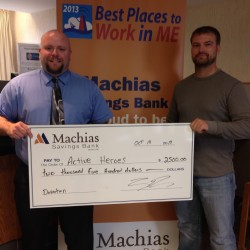 Jason Appleby (left), Machias Branch Manager and Assistant Vice President, presents a check for $2,500 to retired Navy Corpsman Shawn Goodwin, who organized the ATV Ride for a Reason in Machias, scheduled to start at noon Saturday, Oct. 18. The ride benefits Active Heroes, an organization devoted to reducing military suicides.
