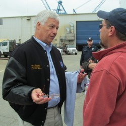 U.S. Rep. Mike Michaud, the Democratic nominee for governor in the 2014 election, talks with Bath Iron Works union representative Kelly Ammons of Topsham during a visit to the shipyard on Wednesday, Oct. 1, 2014.