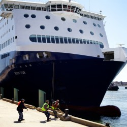 Dockworkers haul a bowline around a bollard as the Nova Star arrives in Portland for the first time on Thursday, April 17.