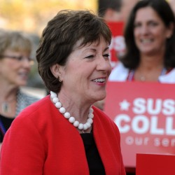 Sen. Susan Collins talks to supporters before she embarked on her statewide bus tour in August.