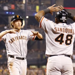 Pablo Sandoval (48) of the San Francisco Giants and Hunter Pence celebrate the grand slam of teammate Brandon Crawford (not pictured) during Wednesday night's National League Wild Card playoff game against the Pittsburgh Pirates. The Giants won 8-0.