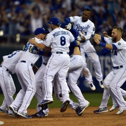 The Kansas City Royals celebrate after catcher Salvador Perez (13) hit a walk-off single against the Oakland Athletics during the 12th inning of the American League Wild Card playoff at Kauffman Stadium in Kansas City Tuesday night. The Royals won 9-8.