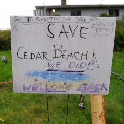 A sign celebrates the September court decision allowing public access to Cedar Beach on Bailey Island. The ruling is now being challenged.
