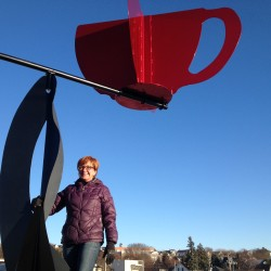 South Portland artist Jac Ouellette built a kinetic coffee cup sculpture, now installed atop Coffee By Design on Diamond Street.