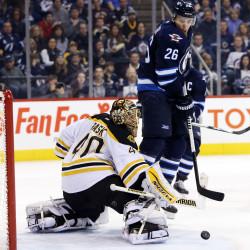 Boston Bruins goalie Tuukka Rask (40) makes a save during the second period against the Winnipeg Jets Friday night in Winnipeg, Manitoba.