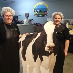 Founders of Casco Bay Butter Co. Alicia Menard and Jennell Carter, from left to right, pose with their resident cow Moonique in their new Pine Point headquarters.