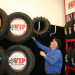 Kendall Howlett, commercial manager for VIP Tires and Service, was busy Thursday setting up a tire display at VIP's new location, the site of the former Sears Auto Center in the Aroostook Centre Mall in Presque Isle. Crews begin operations at the new location Feb. 1.