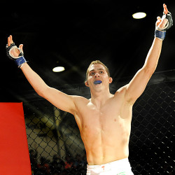 Ray Wood celebrates his first professional bout debut win over John Raio in November 2012 at the Androscoggin Bank Colisee in Lewiston.