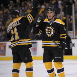 Bruins beat up Islanders for sixth straight victory