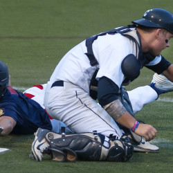 Post 51's Zach Mathiev (left) avoids the tag at home past Coffee News' Sam Huston during their American Legion baseball tournament game on Friday at Husson University in Bangor.