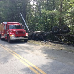 A logging truck rolled over on the Blaine Road in Guilford Thursday.