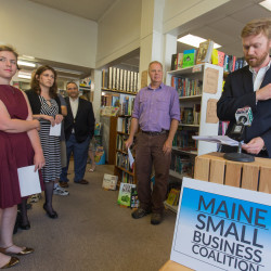 Will Ikard, director of the Maine Small Business Coalition, speaks at a press conference at The Briar Patch bookstore in Bangor on July 29. He introduced many small business owners who spoke and showed their support for the minimum wage increase that will be on the 2016 ballot.