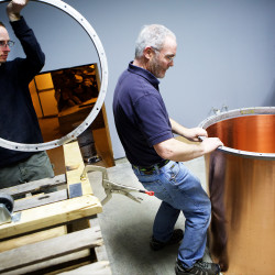 David Woods II (left) and his father David Woods of Wiggly Bridge Distillery work on constructing a still at their secondary location in a barn on Route 1 in York on Wednesday. They opened the distillery in 2013.