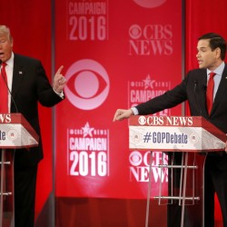 Republican presidential candidate Donald Trump (Lleft) and Sen. Marco Rubio (right) speak at the same time as they discuss an issue at the Republican debate sponsored by CBS News and the Republican National Committee in Greenville, South Carolina, Feb. 13, 2016.