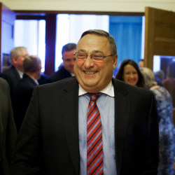 Gov. Paul LePage smiles in Augusta after swearing in House members, Dec. 3, 2014.