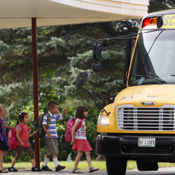 Students board the bus after the first day of school at Vine Street School in Bangor on Sept. 2, 2014.